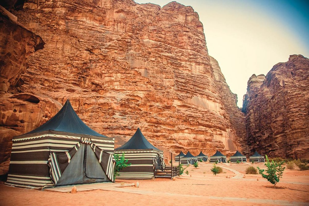 Traditional Bedouin tents get a luxury makeover for glamorous camping in the desert. Popova Tetiana / Shutterstock