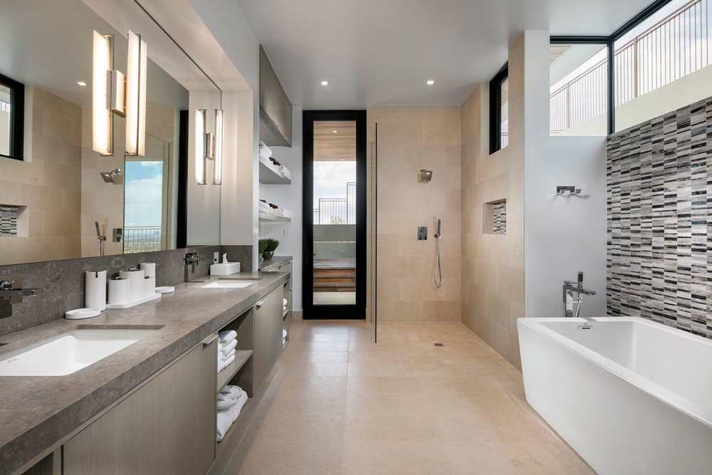 Master bathroom, with standing shower, view from inside going to outside entrance, to the pool and spa. There is also a master bath sitting room, and entrance from the master bedroom.