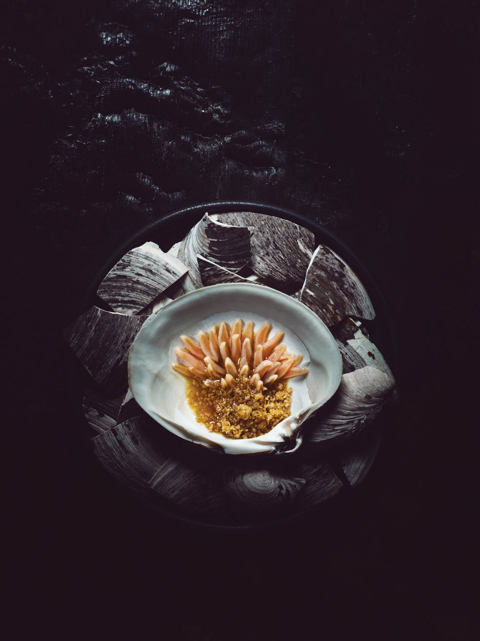 Mahogany clams, raw and diced, served with a dashi of Norwegian shiitake mushrooms from Telemark, and seaweed.Photography by Tuukka Koski