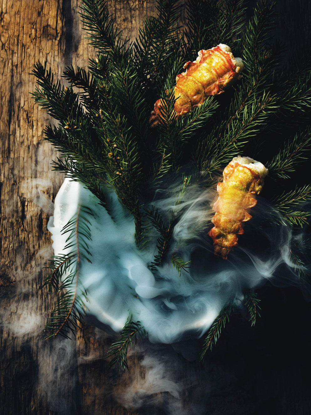 Maaemo's signature dish: fresh langoustine, with pickled spruce and cold-pressed rapeseed oil poured over dry ice to create a scent of primitive Norwegian forests.Photography by Tuukka Koski