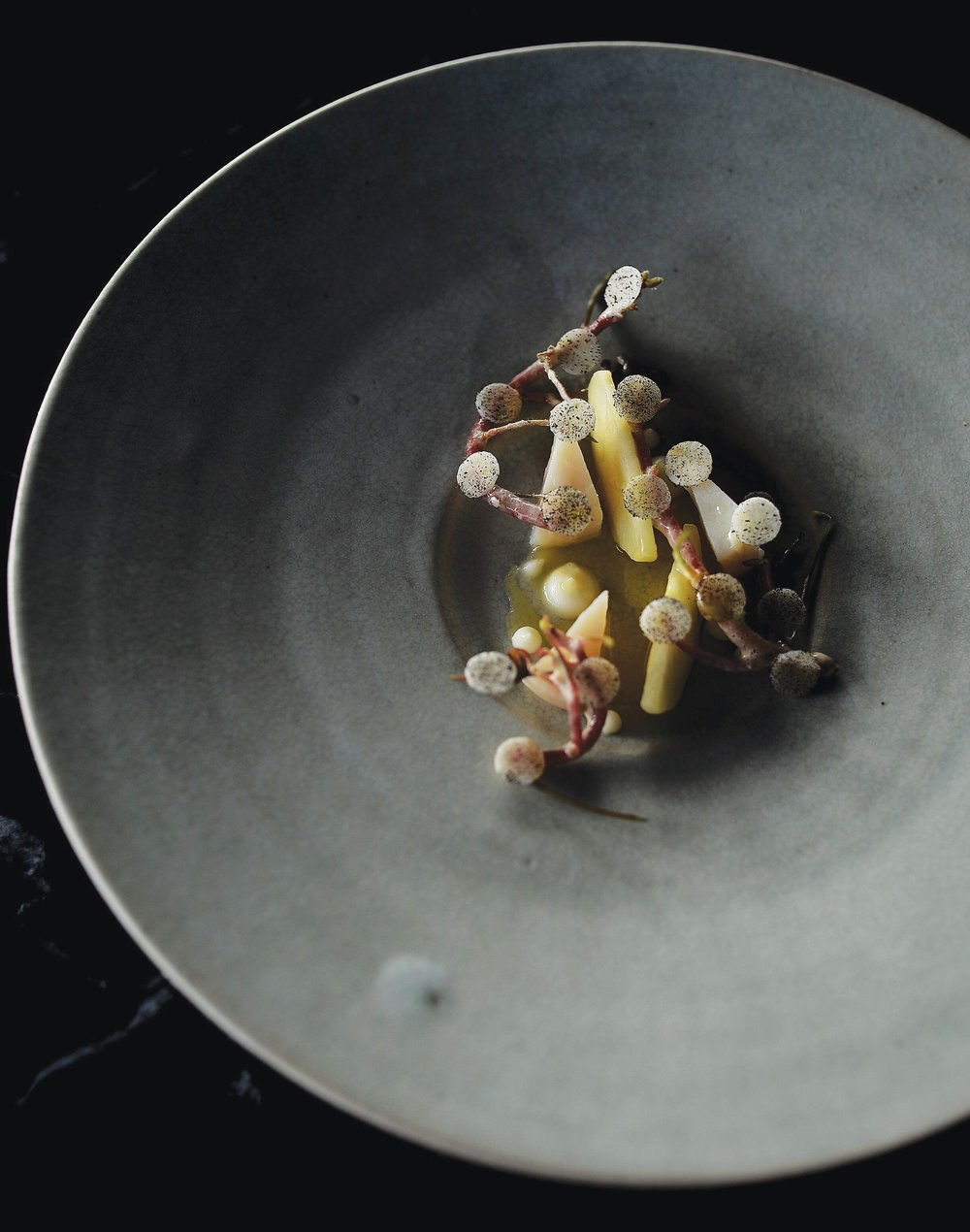 Scallops from the Trondheim coast in Arctic Norway, grilled in the shell, with winter apples and celeriac.Photo Courtesy of Maaemo