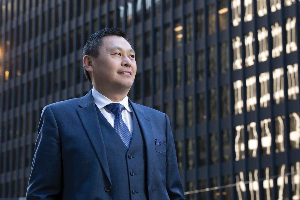 Jim Zhang immigrated from China and became one of Canada's top private bankers.