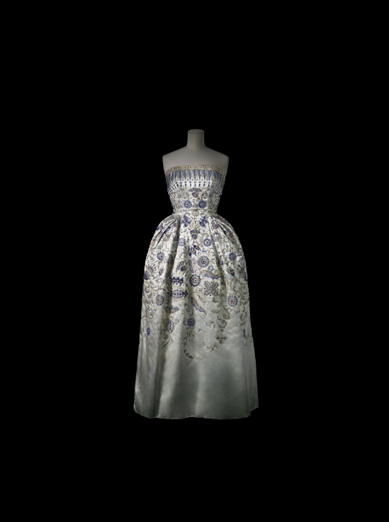 Dior made lavish use of embroidery in his designs. The iconic  Palmyre  evening gown (1952) is made of a sugared almond blue satin. Its stylised floral motifs, reminiscent of those found in Islamic art, are embroidered with silver and gold threads, gemstones, pearls and Swarovski crystals.