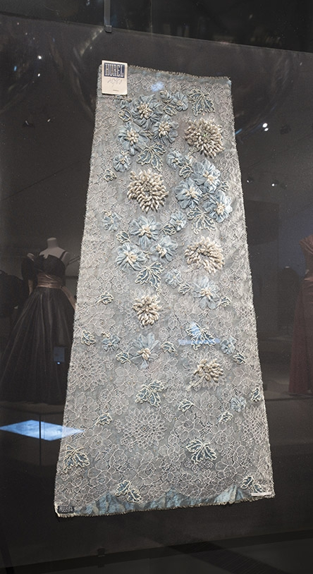 Dior depended on a pyramid of crafts people from textile manufacturers to embroiderers to make his design a reality. The French 'living heritage company' Hurel established in 1879, provided Dior with beautiful, intricate embroidery, such as this floral motif design.