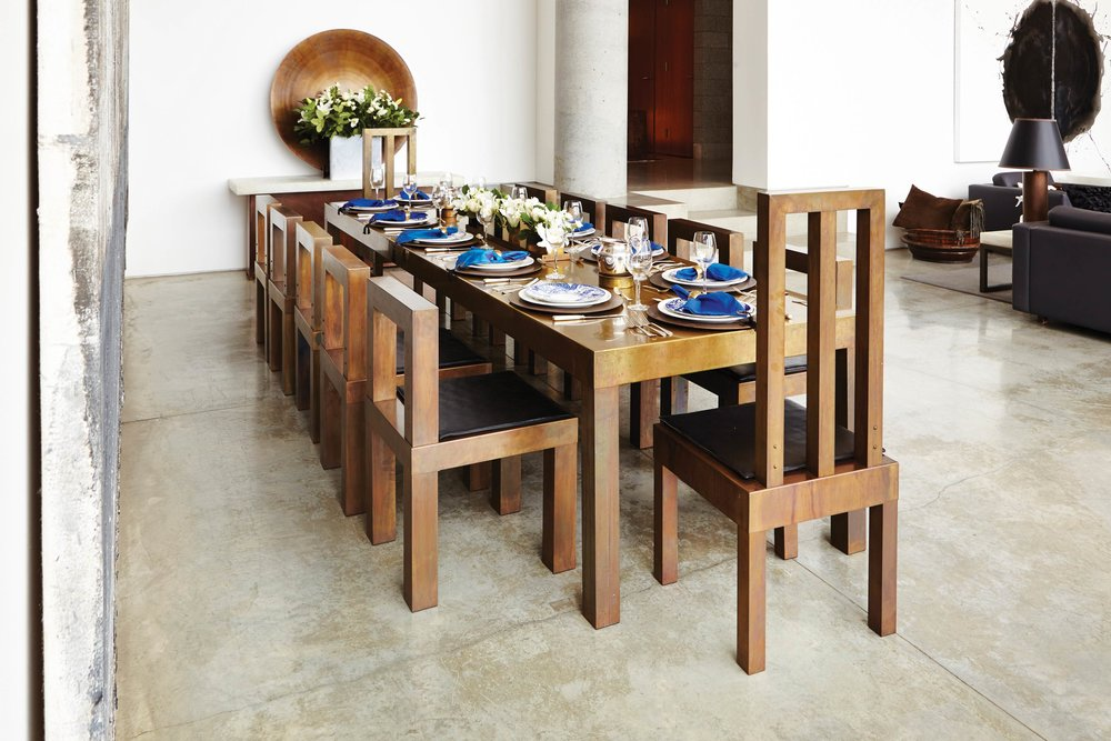 Martha Sturdy brass dining table and chairs in Sturdy's home in West Vancouver;Photography by Raeff Miles
