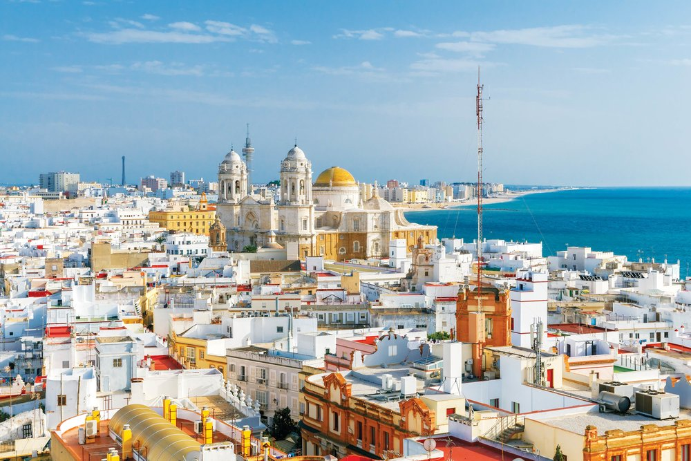The dome and bell towers of the cathedral dominate the Cádiz Skyline. kavalenkau / Shutterstock.com