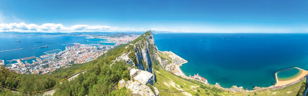 The seaside town of Gibraltar lies beyond the great cliff.Benny Marty / Shutterstock.com