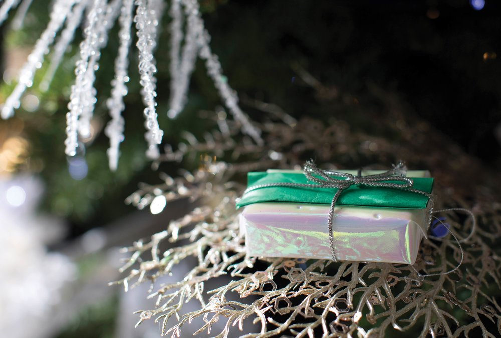 A melange of Homes for the Holidays décor ideas: the dining table, holiday food, place settings, Christmas wrapping, centrepieces for coffee tables. Courtesy of University Women's Club of Vancouver at Hycroft, GardenWorks, and Once a Tree Furniture.