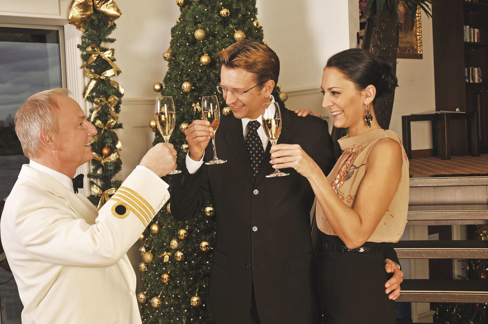 The cruise captain toasts travellers on the Christmas Markets Cruise.