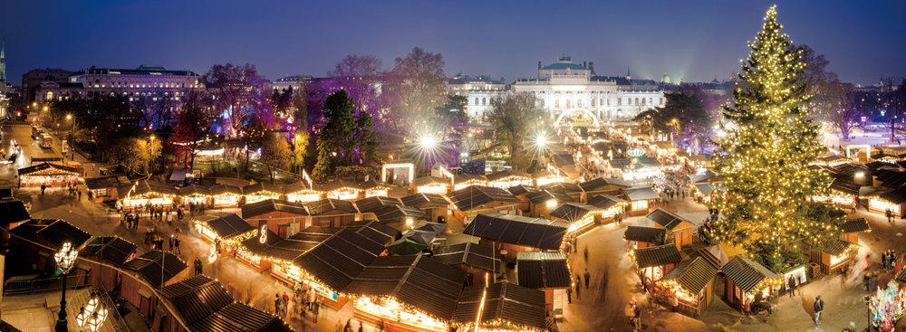 Coloured lights at the Christmas markets at the Rathausplatz in Vienna.Calin Stan/Shutterstock.com