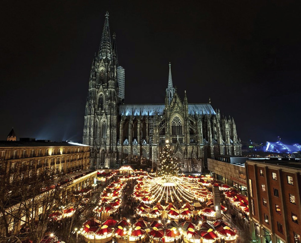 One of the Cologne Christmas markets in the shadow of the old Cologne Cathedral, which began construction in 1248. AMA Waterways