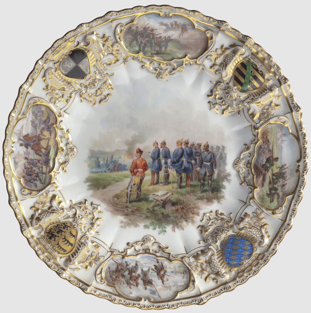 An exclusive gift from the House of Hohenzollern to the Royal Houses of Saxony, Bavaria and Württemberg, the 1896 Meissen plate Kaiser Wilhelm II commemorates the 25th anniversary of the foundation of the Reich, with white glazed porcelain, intricate gold detail and hand-painted coat of arms. INTERFOTO / Alamy Stock Photo