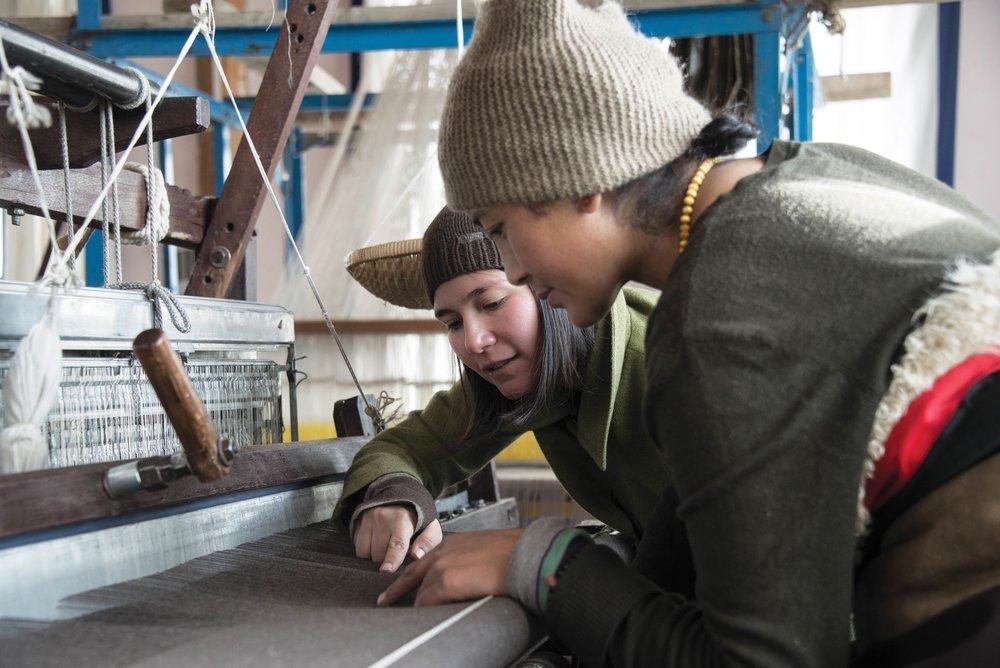 Yeshi instructs an artisan.