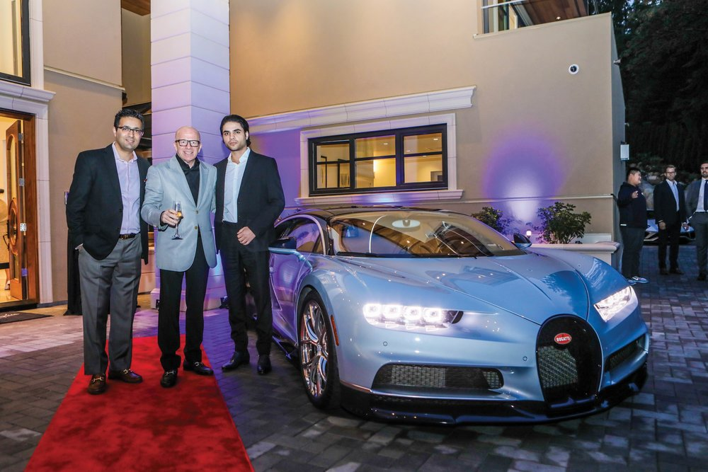Kia Ghaffari, Malcolm Hasman, and Ramtin Farzad (Owner of RCC group) stand next to one of the stars of the event, the Bugatti Chiron.