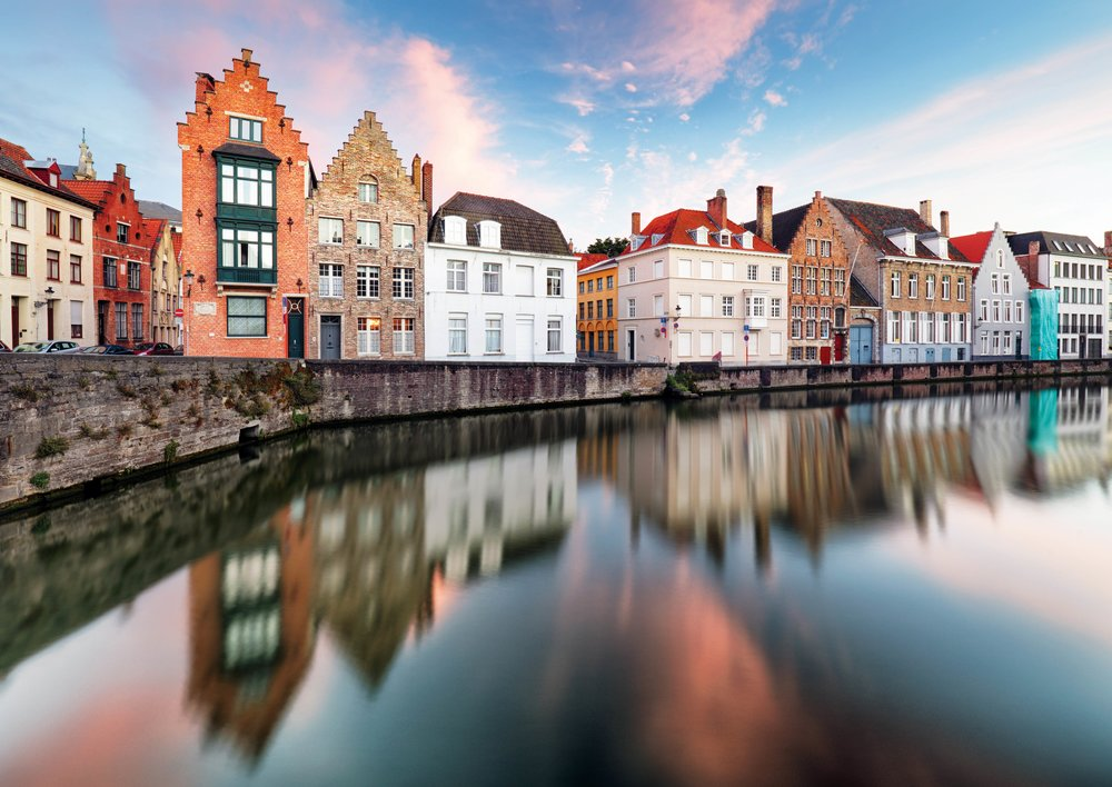View from the canal of a traditional row of Flemish houses in Bruges. TTstudio / Shutterstock.com