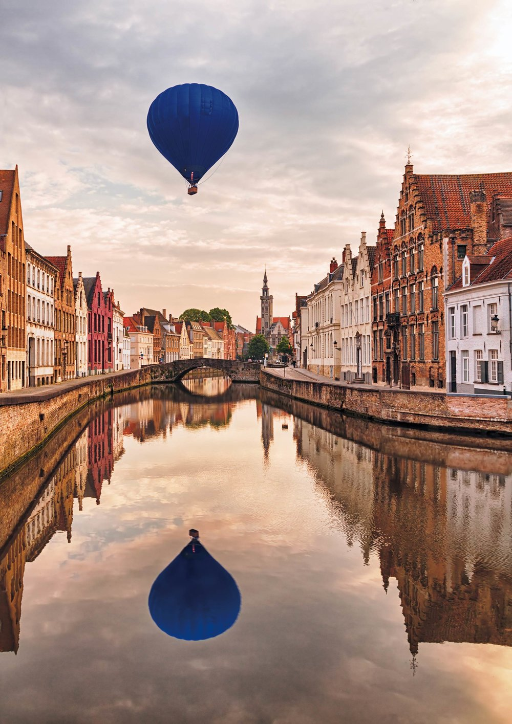 A romantic hot-air-balloon ride over the canals at sunset. irakite / Shutterstock.com