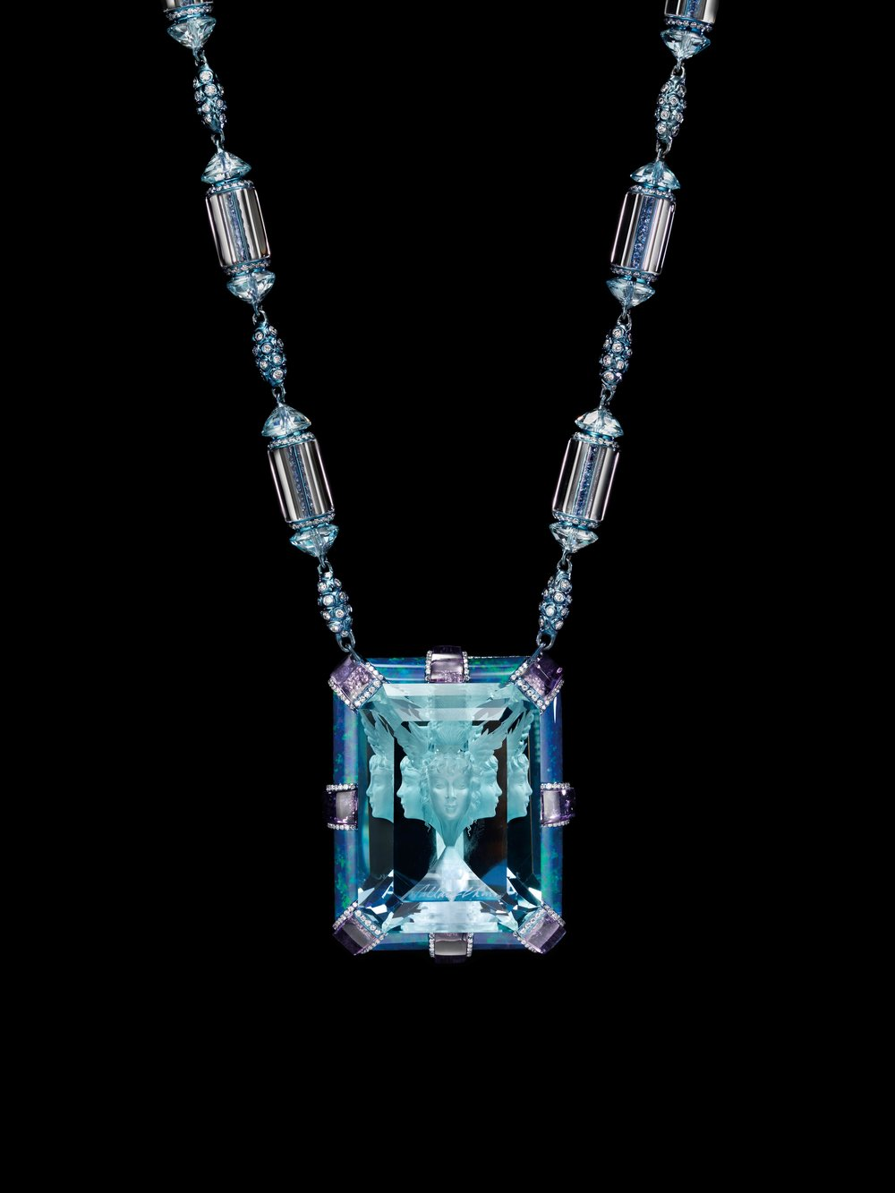 Necklace Now and Always   Aquamarine (Wallace Cut) 135.4ct, Amethyst, Diamond, Blue Topaz, Sapphire, Opal. This majestic jewellery piece is themed on the world-renowned Wallace Cut, invented by Wallace Chan in 1987. The face looking at the viewer is the actual carving. The other four faces are reflections in the facets.