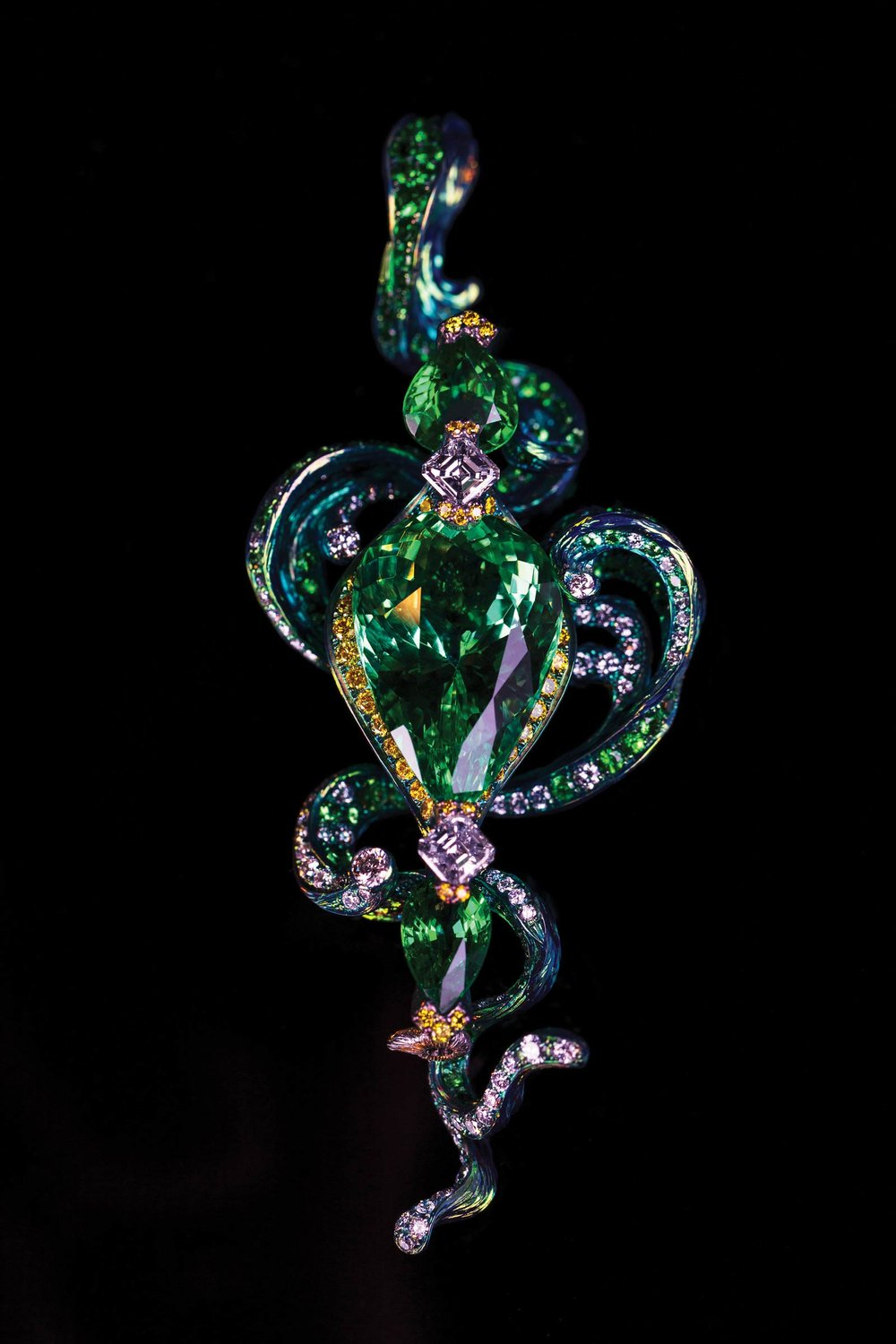 Transformable Brooch, Necklace The Waves   The interaction of light playing off of the gemstones creates reflections that add a new perception of depth. Around the wings' edges, diamonds are set on titanium, adding further dimensionality as the butterfly glides through the air.