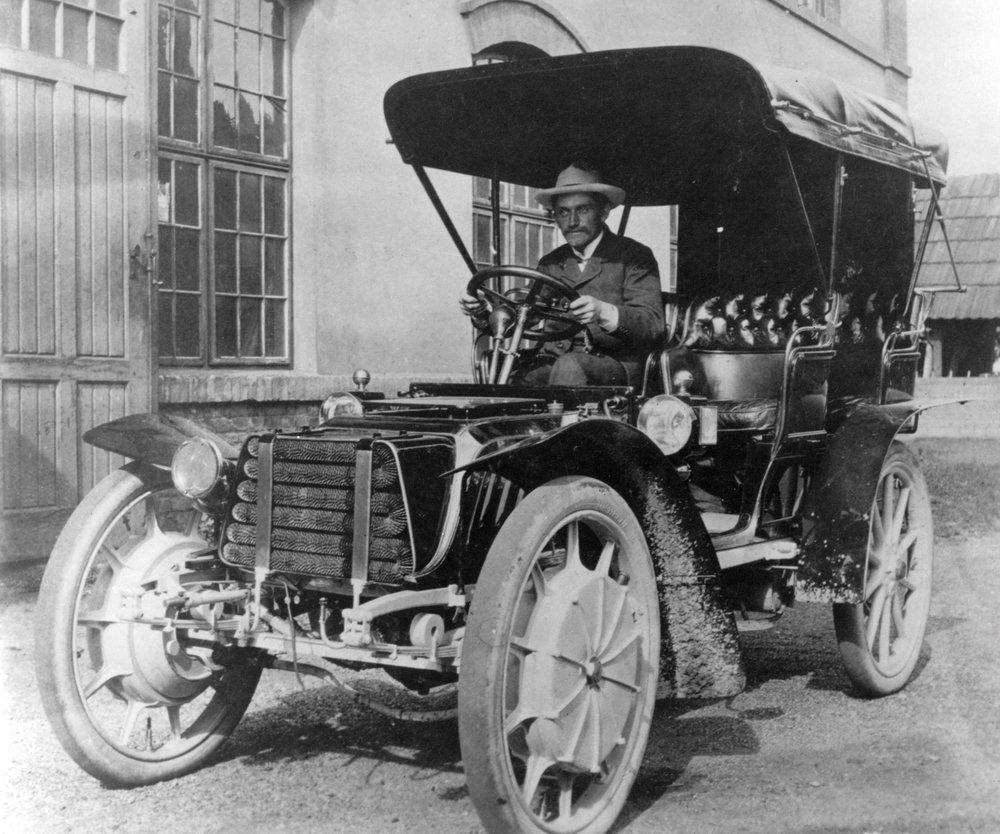 "Ferdinand Porsche at the wheel of one of his 1903 Lohner-Porsche ""hybrid"" touring cars."