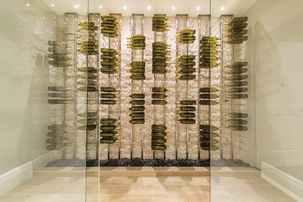 The wine vault — the lower area of this home has a walk-in, air-conditioned area for wine storage. The glass doors, seen left and right, close to keep the area properly air-conditioned.