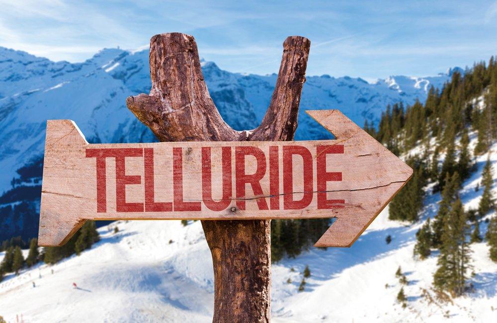 A rustic sign denotes the Telluride area;