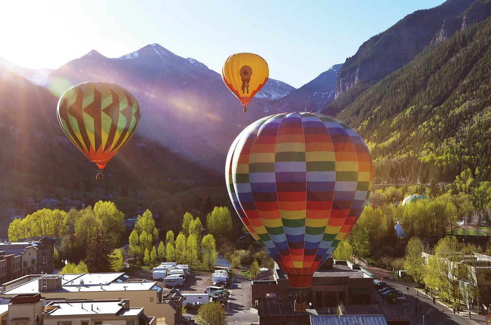 Hot air balloons ascend at sunrise during the festival.Tita77 / Shutterstock.com