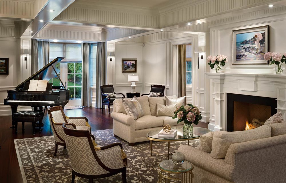 A baby grand piano makes the living room not only a place for cozy lounging by the fire, but also a perfect room for entertaining. The carpets in both living and dining rooms were custom designed by HB Design and handwoven by Salari Fine Carpet Collections in Vancouver.