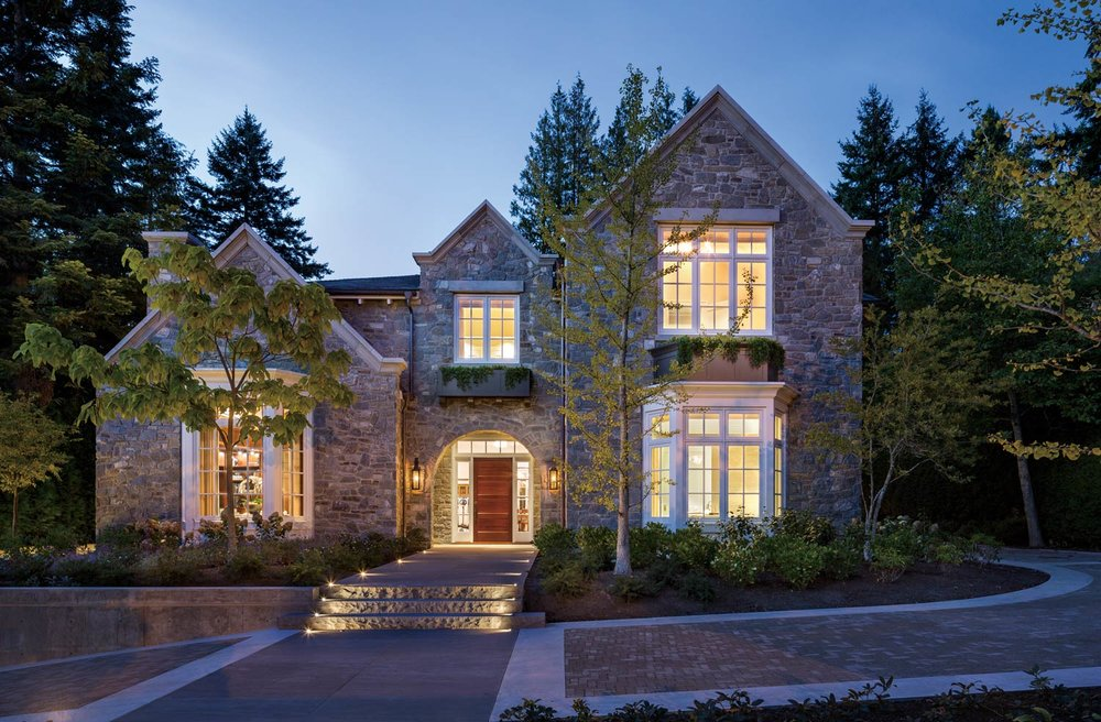 In a traditional Tudor style, the home has a classic exterior of grey stone. But features such a red front door add a surprise of contemporary style.