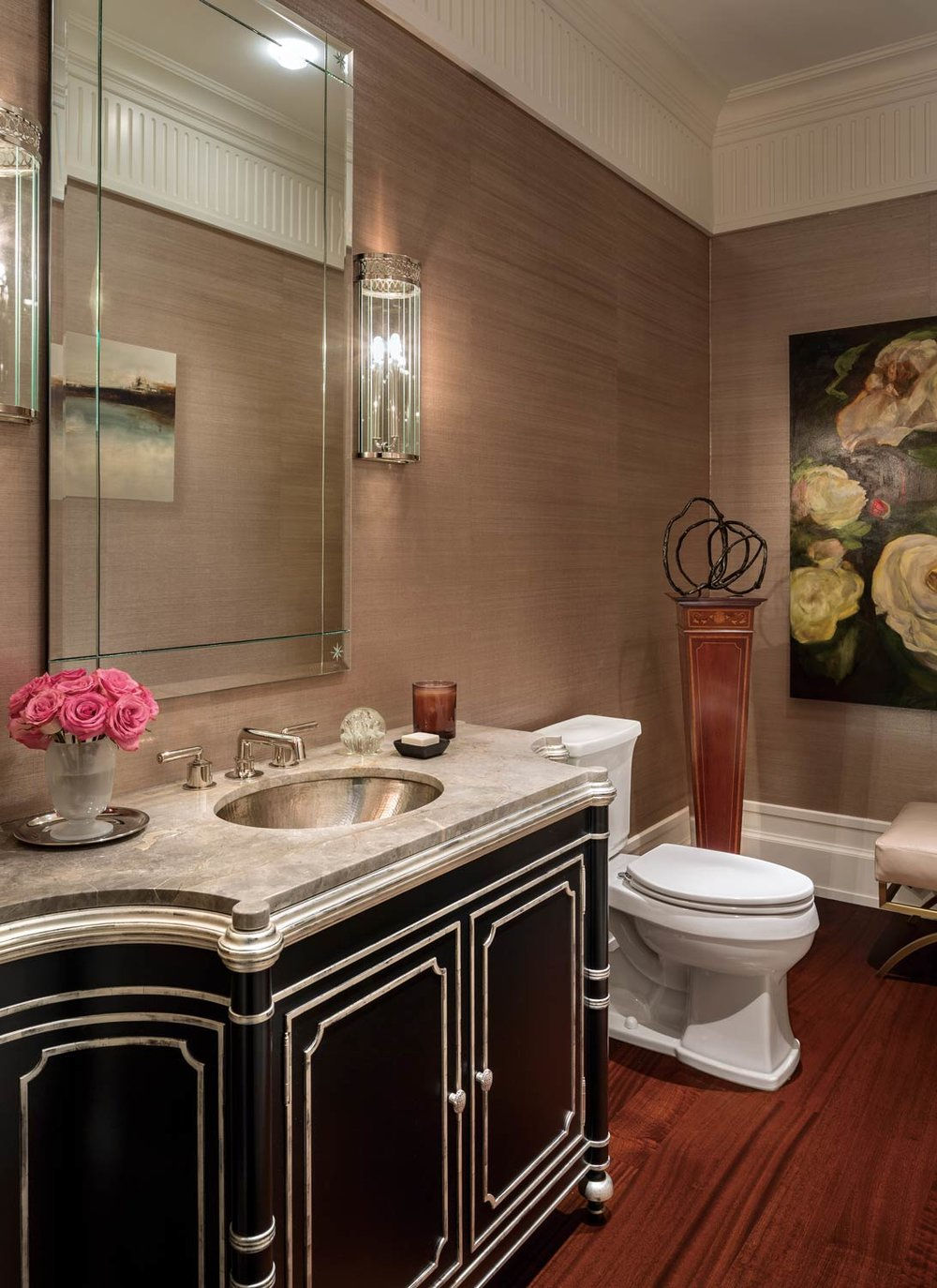 One of the guest bathrooms is hung with silk grasscloth wallpaper by Phillip Jeffries. The painting of white peonies is by local Vancouver artist Bobbie Burgers.