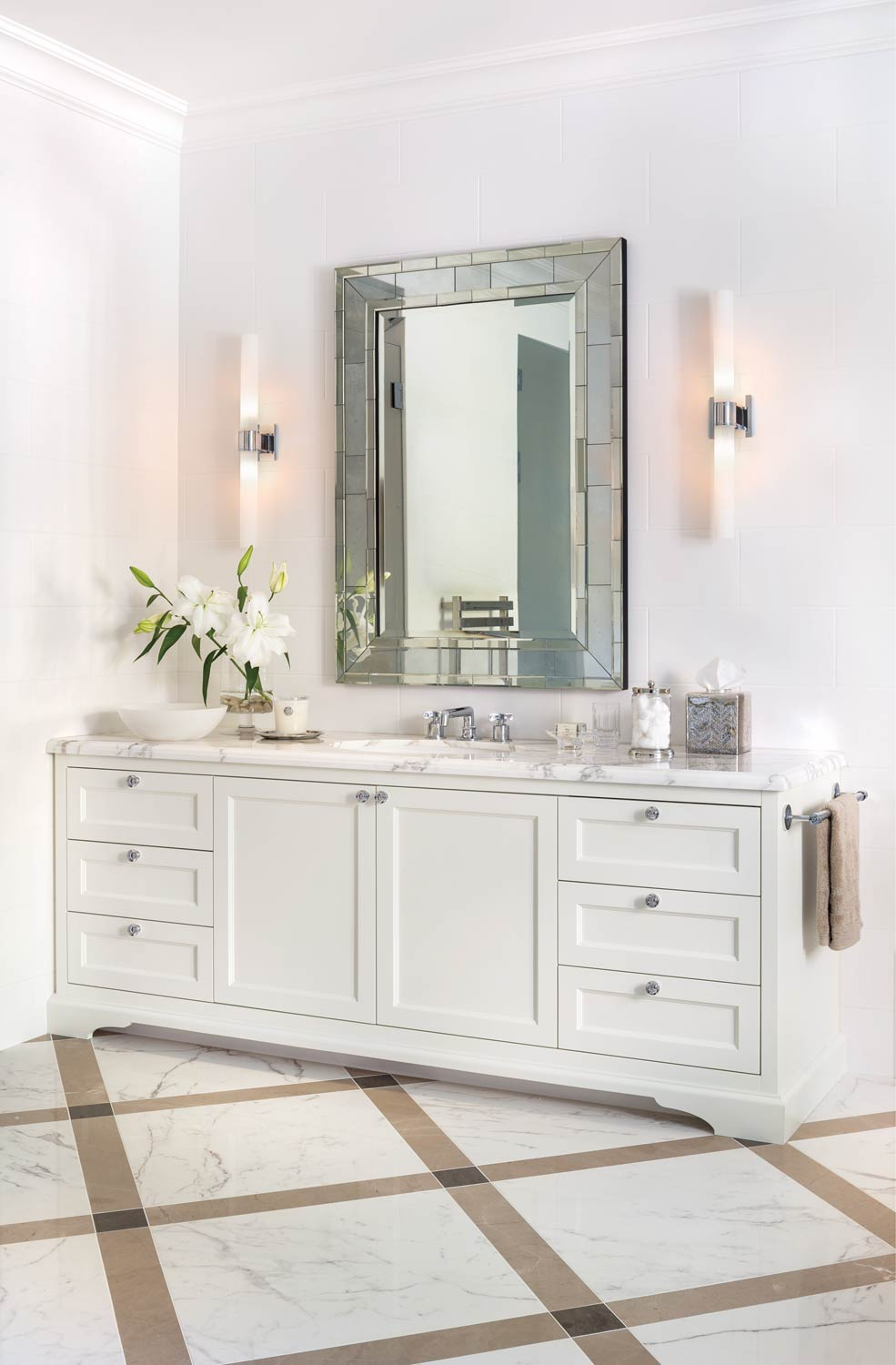 Over the vanity in the master bathroom is a faceted-border mirror.