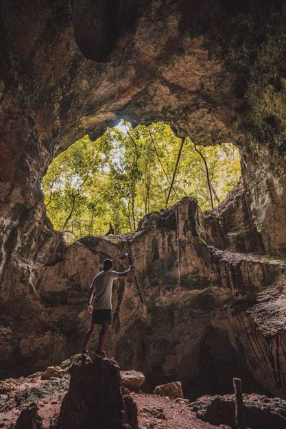 Natural light floods in through an open hole inside of one of the deep caves of Los Haitises National Park.Photography by Nick Argires
