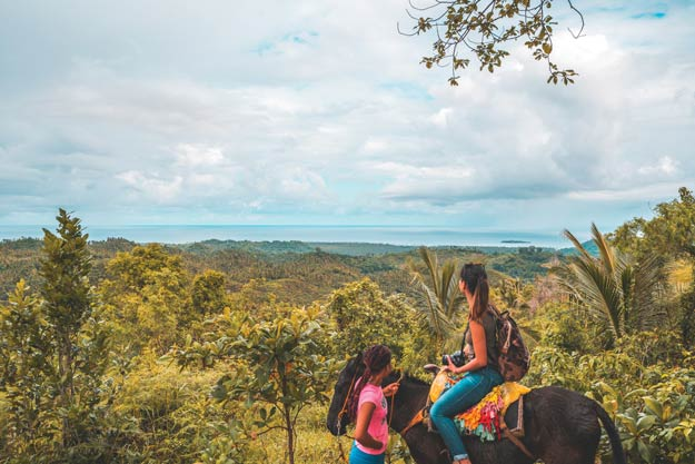 Horseback riding tours led by locals bring travellers into the heart of the thick, lush and scenic El Limón Forest.Photography by Nick Argires