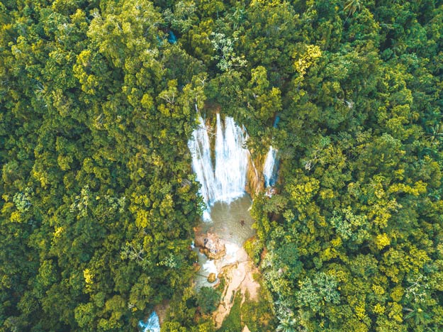 An adventurous, three-hour guided tour leads travellers to the the core of El Limón Forest, where a 52-metre-tall waterfall barrels down the jungle's lush peaks.