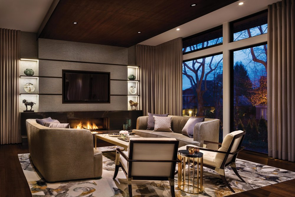 In essence, the family room is a pavilion in the garden. Decorative trees and hedges act as a backdrop at either end, creating privacy and a theatre-like stage set. The fireplace features a cross-cut marble surround and polished Aeon tile.