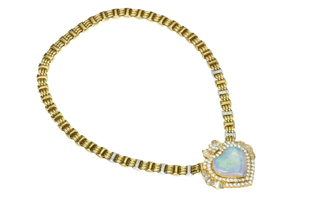 Necklace featuring yellow and white gold and an opal heart, shaped with round and baguette diamonds.  At DSF Antique Jewelry by appointment.  (929) 316-2746, dsfantiquejewelry.com