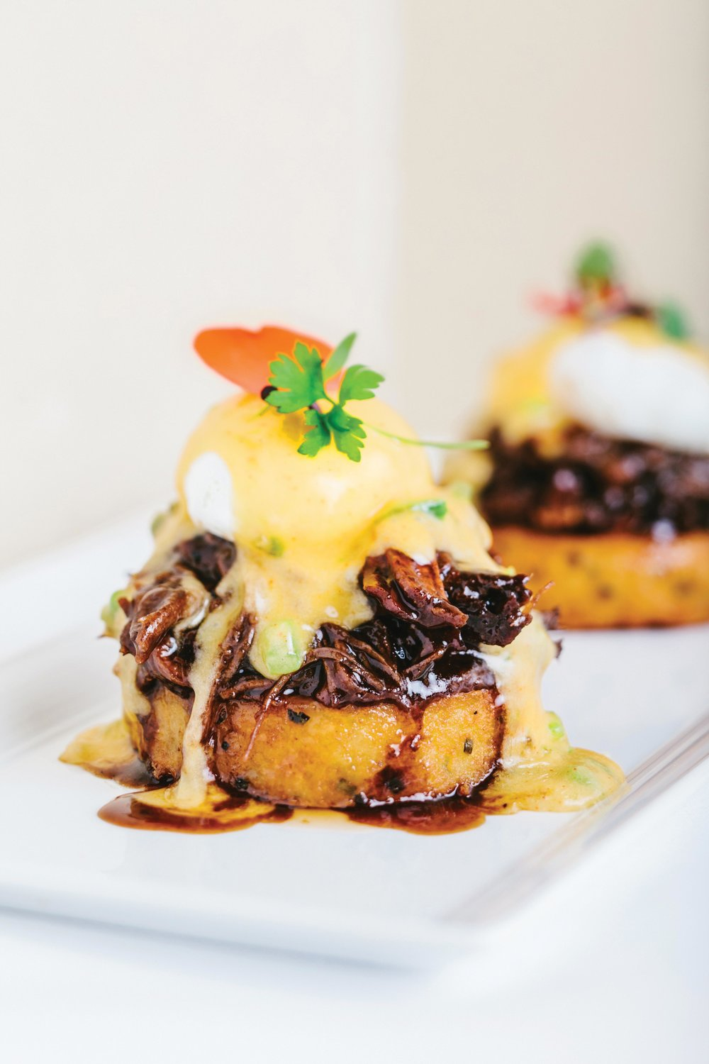 Chef Keller's Hangover Angus Short Rib Benedict — the short rib is slowly cooked and placed on top of a potato cake. A jalapeño-based hollandaise sauce tops the short rib, and atop that is a poached egg. This is part of the Fleur brunch experience.Photos Courtesy of Mandalay Bay