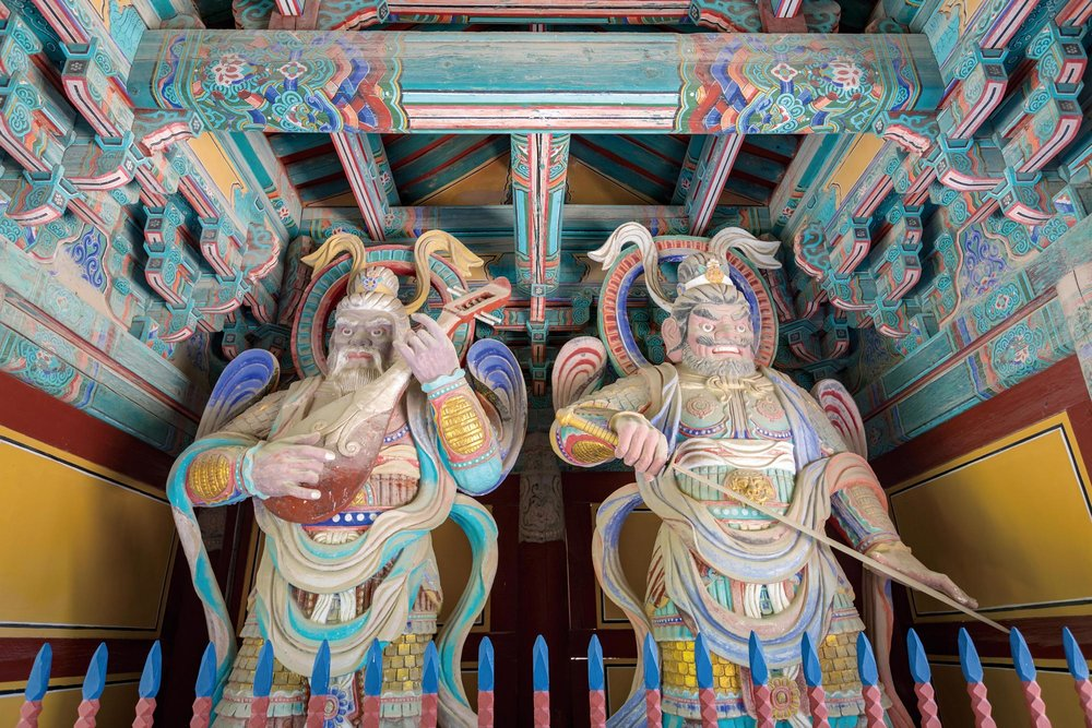 A pair of vibrant heavenly kings guarding the palace in the four cardinal directions.Vincent St. Thomas / Shutterstock.com