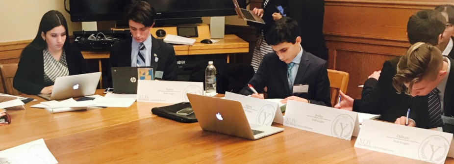 Delegates at work during unmoderated caucus