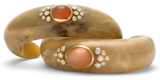 Hand-carved cuffs of vintage bakelite with diamonds and moonstone in 18 karat gold.