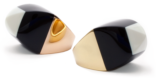 "Hand-carved vintage bakelite ""sugarloaf"" rings mounted in 18 karat rose and yellow gold."