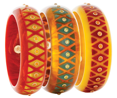 Inlaid bangles of vintage bakelite with citrines, peridots and mandarin garnets mounted in 18 karat gold.