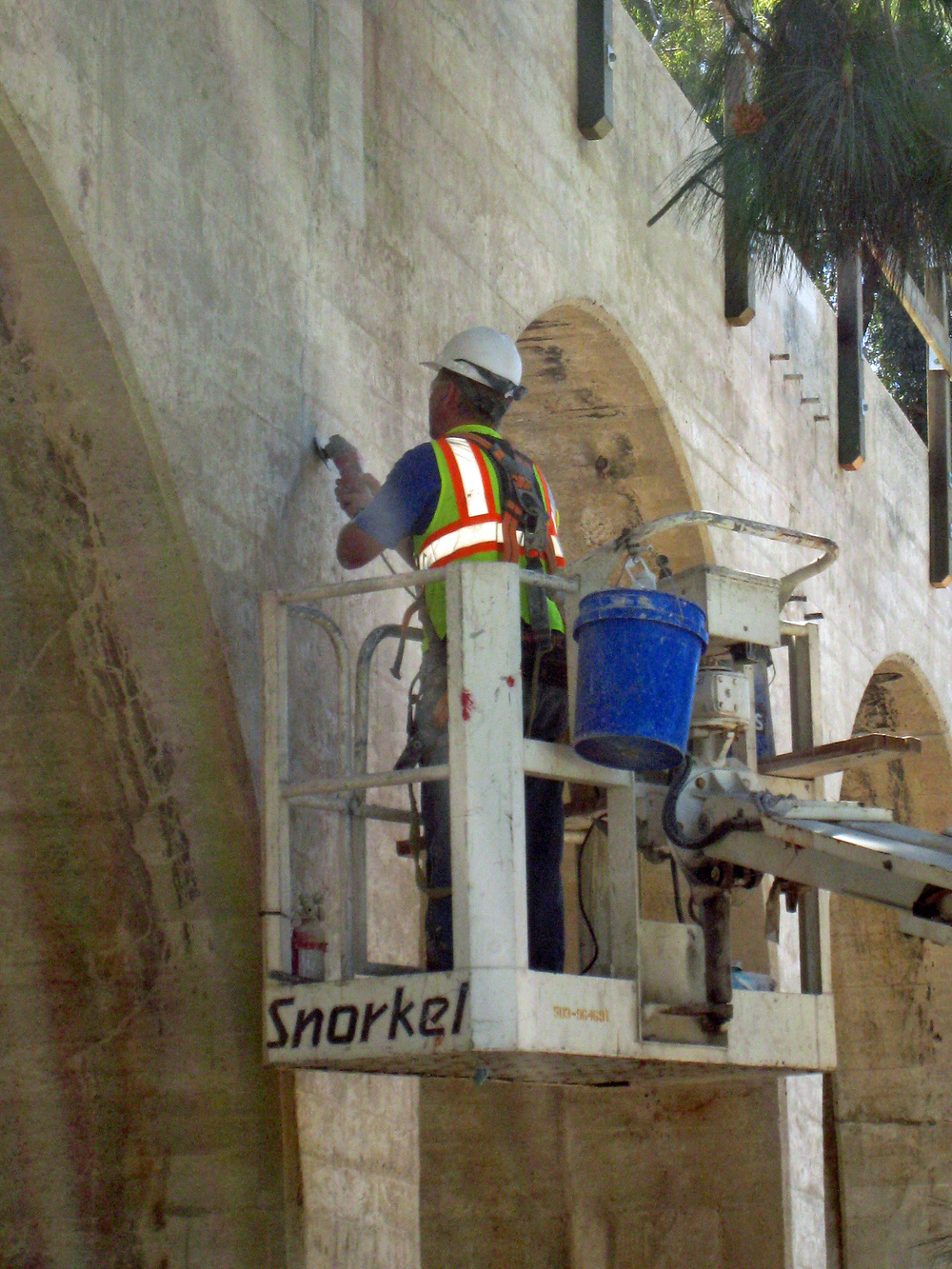 Workers carefully patched damaged concrete to match the original.