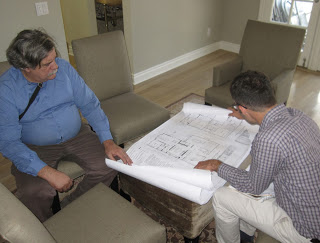 Consultant Charlie Fisher (left) and Chattel Associate Shane Swerdlow (right)   review rehabilitation plans for a proposed Mills Act property.