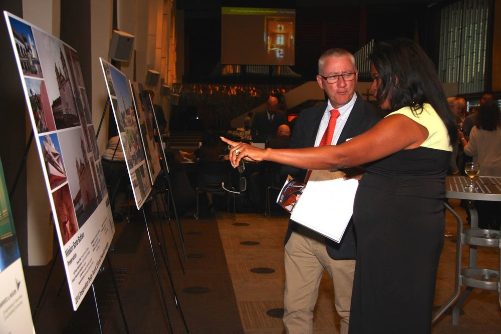 Awards attendees admire and discuss the Mission Santa Barbara project poster during the cocktail hour.