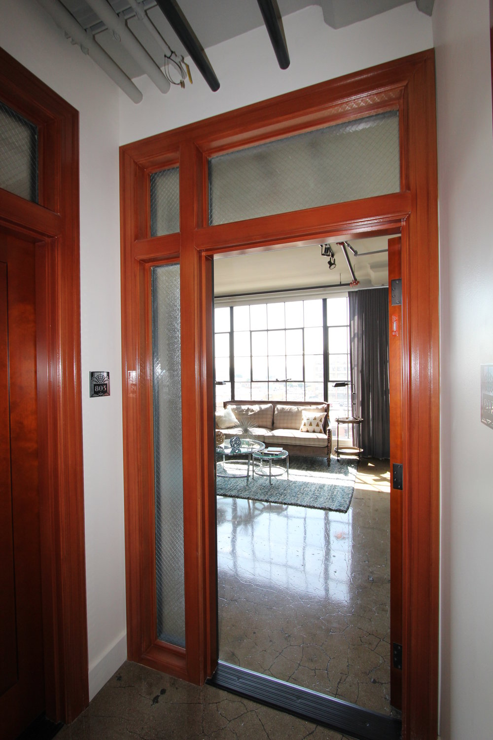 Interior wood door to unit, after rehabilitation.