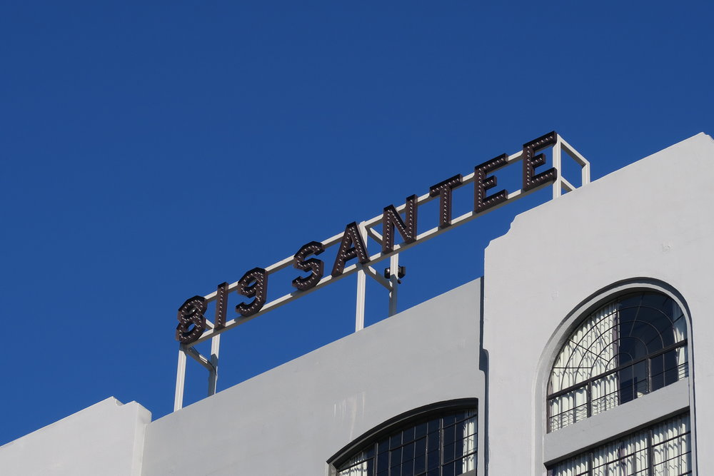 Rooftop sign after rehabilitation.