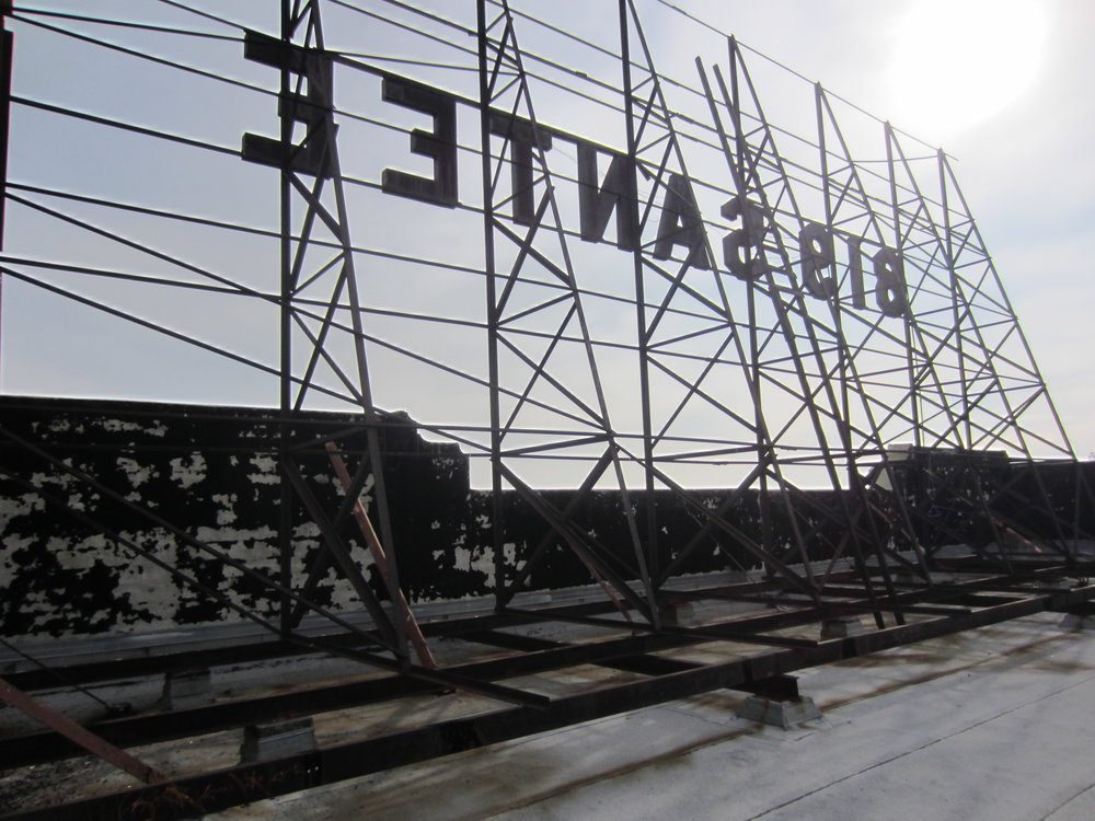 Rooftop sign before rehabilitation.