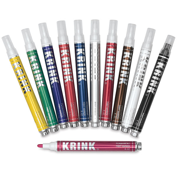 Krink Paint Markers - Great for working over inks! They come in endless colors, sizes and brush types.