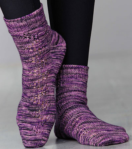 Licorice Laces (Creative Knitting Magazine, April 2015 Special: Just in Time Knits, featuring Candy Skein Yummy Fingering): a toe-up, fleegle heel sock with mirrored lacework.