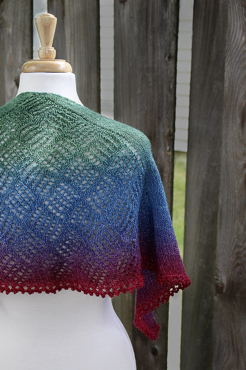 Thanos Theory - a fingering weight single-skein hand knit crescent shaped shawl with a simple lacework center panel and a picot bind off edge.